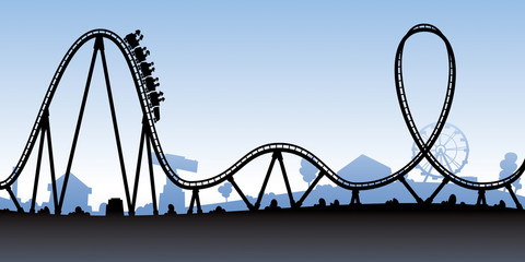 A silhouette of a cartoon roller coaster about to go down a large hill.