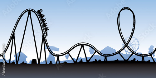 A silhouette of a cartoon roller coaster about to go down a
