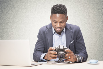 African man with professional camera
