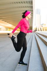 Woman listening to music doing fitness
