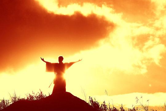 Silhouette monk on the mountain prayer moses faith god