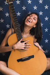 Smiling female with guitar