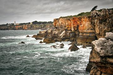 Coastline near Cascais, Portugal. Rugged coast. Stormy weather.