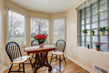 Light filled breakfast nook with soft peach walls