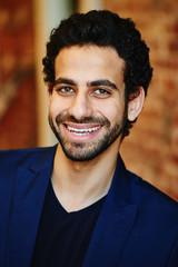 Portrait of Arab man in a blue suit closeup