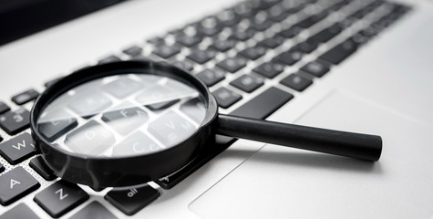 Searching On Internet Concept, Magnifier On Computer Keyboard
