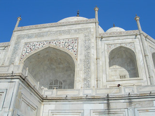 Close perspective angle of the Taj Mahal mausoleum in Agra, India, with the main building dome and the entry portal