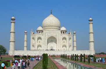 Iconic perspective of the Taj Mahal mausoleum in Agra, India, with the reflection pool and the main building dome framed by the minaret towers.