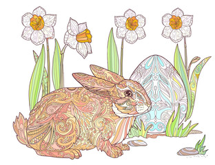 Happy Easter rabbit with egg, and spring flowers of a daffodil.