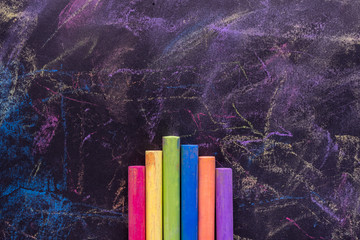 chalks in a variety of colors on black background.