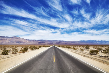 Endless desert road in the Death Valley, travel concept, USA.