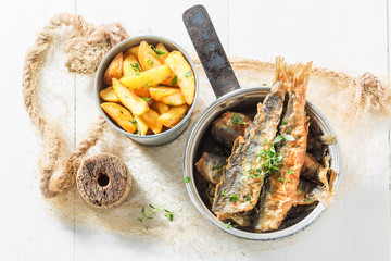 Homemade roasted herring fish with herbs and salt