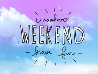 Woohoo weekend have fun word on pink and blue pastel sky