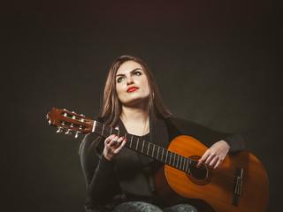 Disabled girl playing guitar.