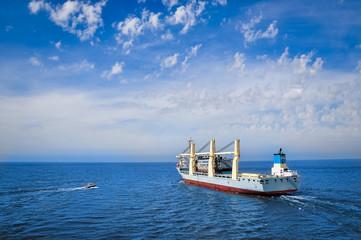 Heavy lift vessel leaving a port
