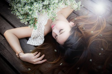 Beautiful woman lying on the wooden floor