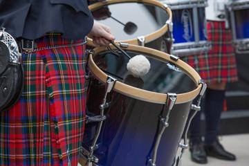 Orchestra performing outdoot closep drum kilt