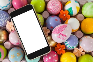 Mobile phone on painted easter eggs