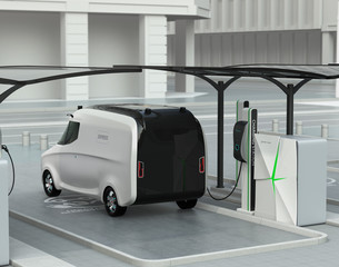 Rear view of delivery van in charging station. The charging station installed with solar panels. 3D rendering image.
