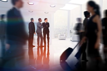 Composite image of business colleagues looking