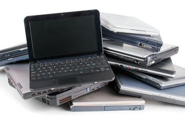 Stack of used laptops for recycle , white background Wall mural