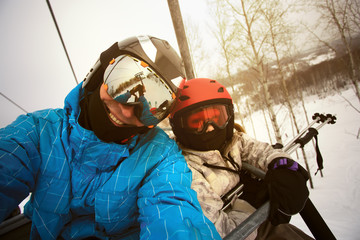 Dad with his daughter skiers