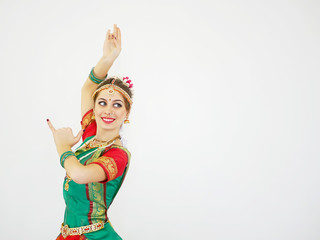 Beautiful Indian dancer on a white background