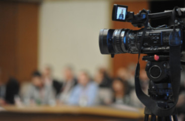 Abstract blurred background of video camera recording in conference