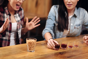 Close up of wooden table being full of glasses