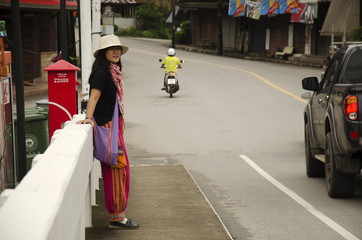 Thai woman walking on street and Traffic road on the brigde at Old Town Chanthaboon