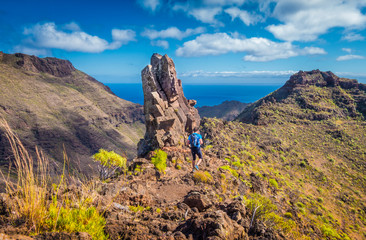 Hiker on a trail in the Canary Islands, Spain