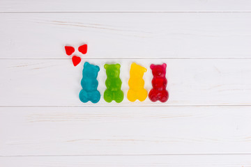 Jelly candies in the form of a multicolored gummy bears with hearts
