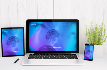 Wall Mural - devices on table with cool responsive design website