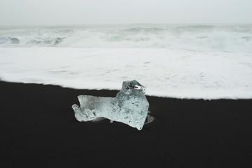 Piece of Ice on Black Iceland Beach