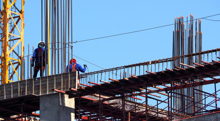 Building construction site and worker.