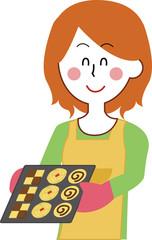 クッキーを作る女性のイラスト