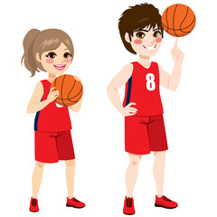 Young basketball children players standing with ball
