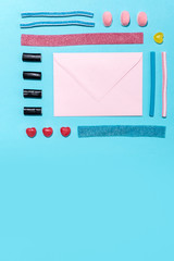 Photo of blank paper envelope with colorful sweet sugar candies