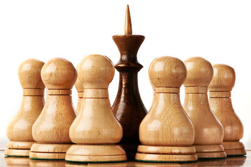 White and black chessmen on chessboard