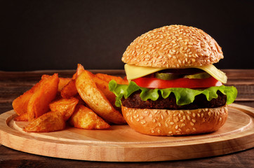 Big burger with beef, tomato, cheese and lettuce and french fries