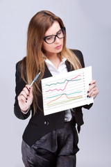 Elegant business woman explaining a graphic on a chart