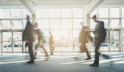 abstract blurred business people walking
