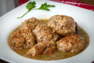 Pork meatballs with dill sauce.