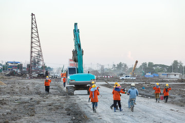 workers are going back home after finish work at construction site