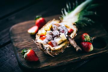 fresh fruits salad in pineapple cut in half