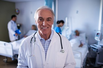 Portrait of male doctor smiling in the ward
