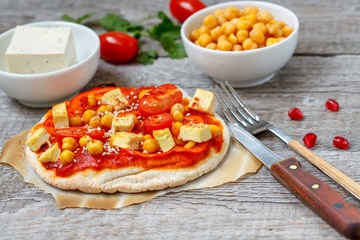 Homemade vegan pizza with chickpeas and tofu. Love for a healthy vegan food concept