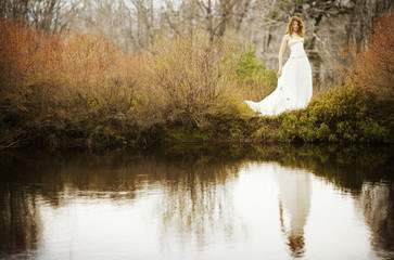 Portrait of Bride reflecting in pond