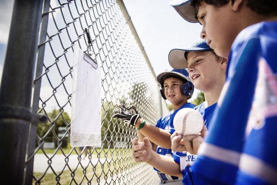 Young baseball players looking at list