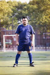 Soccer player standing in sports field